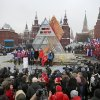 Moscow\'s Mayor Sergei Sobyanin, center, stands surrounded by a crowd of various sports enthusiasts waving Russian and Moscow flags during a ceremony of the launching the one-year count down clock for the upcoming 2014 Sochi Olympics, in Moscow, Russia, Thursday, Feb. 7, 2013. (AP Photo/Mikhail Metzel)