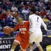 Photo - Ohio State guard Ameryst Alston, left, drives on Penn State guard Dara Taylor in the second half of an NCAA college basketball game in the quarterfinals of the Big Ten women's tournament in Indianapolis, Ind., Friday, March 7, 2014. Ohio State defeated Penn State 99-82. (AP Photo/Michael Conroy)