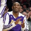 Photo - Los Angeles Lakers' Kobe Bryant reacts from the bench after teammate Xavier Henry scored while being fouled against the Toronto Raptors during the first half of an NBA basketball game in Los Angeles, Sunday, Dec. 8, 2013. (AP Photo/Danny Moloshok)