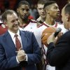 Photo - OU: Joe Castiglione, athletic director at the University of Oklahoma, presents coach Lon Kruger with the game ball for his 500th win during a men's college basketball game between the University of Oklahoma and Northwestern Louisiana State University at the Lloyd Noble Center in Norman, Okla., Friday, Nov. 30, 2012.  Photo by Garett Fisbeck, The Oklahoman