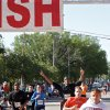 OSU basketball team member, Michael Cobbins, holds his hands up as he crosses the finish line of the Remember the Ten run was in Stillwater, Okla on April 21, 2012. Photo by Mitchell Alcala, for The Oklahoman