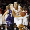 Oklahoma\'s Nicole Kornet (1) drives past Kansas State\'s Kindred Wesemann (24) in the second half during an NCAA women\'s basketball game between the Oklahoma Sooners and the Kansas State Wildcats at Lloyd Noble Center in Norman, Okla., Saturday, Jan. 11, 2014. OU won 61-50. Photo by Nate Billings, The Oklahoman