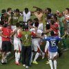 Photo - Costa Rica players celebrate after winning the group D World Cup soccer match between Italy and Costa Rica at the Arena Pernambuco in Recife, Brazil, Friday, June 20, 2014. Costa Rica beat four-time champion Italy 1-0 to secure a spot in the next round. (AP Photo/Hassan Ammar)