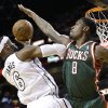 Milwaukee Bucks center Larry Sanders (8) attempts to block a shot by Miami Heat forward LeBron James (6) during the first half of Game 2 in their first-round NBA basketball playoff series, Tuesday, April 23, 2013 in Miami. The Heat defeated the Bucks 98-86. (AP Photo/Wilfredo Lee)