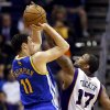 Golden State Warriors\' Klay Thompson (11) shoots over Phoenix Suns\' P.J. Tucker (17) during the second half of an NBA basketball game, Friday, April 5, 2013, in Phoenix. The Warriors won 111-107. (AP Photo/Matt York)