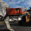 Public works crews in Point Pleasant N.J. remove the ruined contents of homes on Monday, Nov. 5, 2012. A new storm, this one a nor\'easter, is expected Wednesday, raising fears of renewed damage along the already hard-hit Jersey shore. (AP Photo/Wayne Parry)