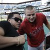 Photo - Los Angeles Angels' Mike Trout poses for a photo with Robert Uribe from Reading, Pa, who attended Millville High School in Millville, NJ with Trout, before the start of a baseball game with the Philadelphia Phillies, Tuesday, May 13, 2014, in Philadelphia. (AP Photo/Laurence Kesterson)