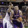 Photo -   Phoenix Suns center Marcin Gortat, right, of Poland, drives to the basket against Sacramento Kings center DeMarcus Cousins during the first half of an NBA preseason basketball game in Sacramento, Calif., Wednesday, Oct. 10, 2012. (AP Photo/Rich Pedroncelli)