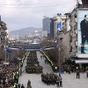 A Kosovo Security Force honor guard leads the parade in the center of Pristina marking the 5th anniversary since Kosovo seceded from Serbia Sunday, Feb. 17, 2013. Serbia rejects Kosovo\'s independence. Banner on wall at right shows the late Kosovo leader Ibrahim Rugova. (AP Photo/Visar Kryeziu)