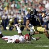Notre Dame\'s TJ Jones (7) is tackled by Oklahoma\'s Julian Wilson (2) during the first half of an NCAA college football game Saturday, Sept. 28, 2013, in South Bend, Ind. (AP Photo/Darron Cummings) ORG XMIT: INDC106
