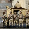 Photo - Egyptian army soldiers take their positions near armored vehicles to guard the entrances of Tahrir square, in Cairo, Egypt, Monday, July 8, 2013. Egyptian military officials said gunmen killed at least five supporters of the former president when people tried to storm a military building in Cairo. The official, who declined to be named because he was not authorized to brief reporters, also said a group had tried to storm the headquarters of the Republican Guard. He added that those killed had been supporters of former President Mohammed Morsi camped outside the building in protest at his overthrow. (AP Photo/Hassan Ammar)