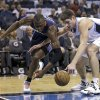 Charlotte Bobcats\' Bismack Biyombo, left, and Orlando Magic\'s Nikola Vucevic go after a loose ball during the first half of an NBA basketball game, Friday, Jan. 18, 2013, in Orlando, Fla. (AP Photo/John Raoux)