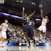 OU\'s Willie Warren shoots the ball over Michigan\'s DeShawn Sims, left, and Manny Harris during a second-round men\'s NCAA college basketball tournament game between Oklahoma and Michigan in Kansas City, Mo., Saturday, March 21, 2009. Oklahoma won 73-63. PHOTO BY BRYAN TERRY, THE OKLAHOMAN