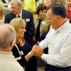 Photo - Former Massachusetts Gov. Mitt Romney shakes hands with supporter Mary Jo Pitzer at Tamarack during the Working for Jobs Rally in Beckley, W.Va., Tuesday, Aug. 19, 2014. (AP Photo/Chris Tilley)