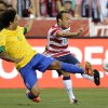 Photo -   United States' Landon Donovan (10) kicks the ball against Brazil's Marcelo (6) during the first half of an international friendly soccer game on Wednesday, May 30, 2012, in Landover, Md. (AP Photo/Nick Wass)