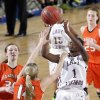 Northeast\'s Lanesia Williams (1) shoots over Fairview\'s Payton Van Meter (14) during the state high school basketball tournament Class 2A girls semifinal game between Fairview High School and Northeast High School at the State Fair Arena on Friday, March 8, 2013,in Oklahoma City, Okla. Photo by Chris Landsberger, The Oklahoman