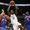 Oklahoma City\'s Jeff Green (22) shoots between Jared Jeffries (20) and Nate Robinson (2) of New York during the NBA basketball game between the Oklahoma City Thunder and the New York Knicks at the Ford Center in Oklahoma City, January 11, 2010. Photo by Nate Billings, The Oklahoman