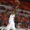 Oklahoma State\'s Michael Cobbins (20) dunks the ball in front of Texas-Arlington\'s Kevin Butler (24) during a college basketball game between Oklahoma State University and UT Arlington at Gallagher-Iba Arena in Stillwater, Okla., Wednesday, Dec. 19, 2012. Photo by Bryan Terry, The Oklahoman