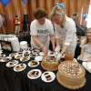 Meg Crosslen, Rebecca Sparks and Sparks\' daughter Eva, 12, prepare Chocolate Amaretto Cream Cake before the annual Chocolate Festival benefiting the Firehouse Art Center on Saturday, February 5, 2011, in Norman, Okla. Photo by Steve Sisney, The Oklahoman