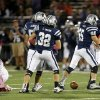Edmond North\'s Sam Delzell, right, and Joel Dixon celebrate after Yukon\'s Hayden Somerville, left, was sacked during a high school football game at Wantland Stadium in Edmond, Okla., Thursday, October 4, 2012. Photo by Bryan Terry, The Oklahoman
