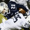 Casady\'s Jay Bozalis (21) is stopped on a carry by Bodee Lammers (25) of All Saints during a high school football game between Casady and Fort Worth All Saints Episcopal at Casady School in Oklahoma City, Friday, Oct. 18, 2013. Photo by Nate Billings, The Oklahoman