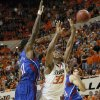 Oklahoma State \'s Marcus Smart (33) is fouled on a shot by Kansas\' Jamari Traylor (31) during the college basketball game between the Oklahoma State University Cowboys (OSU) and the University of Kanas Jayhawks (KU) at Gallagher-Iba Arena on Wednesday, Feb. 20, 2013, in Stillwater, Okla. Photo by Chris Landsberger, The Oklahoman