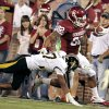 Oklahoma\'s Dominique Whaley (8) is run out of bounds by Missouri\'s Randy Ponder (7) on Saturday. Photo by Steve Sisney, The Oklahoman