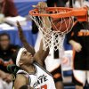 RECROPPED OPTION: OSU COLLEGE BASKETBALL: Oklahoma State University\'s Terrence Crawford (42) dunks against Southeastern Louisiana with OSU teammate Ivan McFarlin (23) in the second half of the first round of the NCAA Tournament at the Ford Center in Oklahoma City, Friday, March 18, 2005. By Ty Russell/The Oklahoman