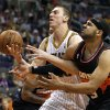 Indiana Pacers forward Tyler Hansbrough, left, battles Phoenix Suns forward Jared Dudley, right, for the loose ball during the first half of an NBA basketball game, Saturday, March 30, 21013, in Phoenix. (AP Photo/Paul Connors)