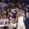 L.A.\'s Luke Walton (4) flips over Eric Maynor (6) during the NBA basketball game between the Los Angeles Lakers and the Oklahoma City Thunder in the first round of the NBA playoffs at the Ford Center in Oklahoma City, Saturday, April 24, 2010. Photo by Sarah Phipps, The Oklahoman