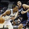 Photo -   Minnesota Timberwolves' Derrick Williams, left, drives around Charlotte Bobcats' Byron Mullens in the first half of an NBA basketball game, Wednesday, Nov. 14, 2012, in Minneapolis. (AP Photo/Jim Mone)