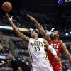 Photo - Indiana Pacers forward Danny Granger (33) puts up a shot while guarded by Atlanta Hawks forward Mike Scott during the second half of an NBA basketball game in Indianapolis, Tuesday, Feb. 18, 2014. (AP Photo/R Brent Smith)