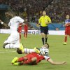 Ghana\'s Harrison Afful is tackled by United States\' Alejandro Bedoya during the group G World Cup soccer match between Ghana and the United States at the Arena das Dunas in Natal, Brazil, Monday, June 16, 2014. (AP Photo/Ricardo Mazalan)