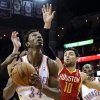 Oklahoma City Thunder\'s Hasheem Thabeet (34) looks to the basket against Houston Rockets\' Carlos Delfino (10) in the first half of an NBA basketball game, Wednesday, Feb. 20, 2013, in Houston. (AP Photo/Pat Sullivan) ORG XMIT: HTR105