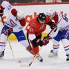 Photo - Ottawa Senators' Andre Benoit (61) tries to get to the puck through Montreal Canadiens' Alex Galchenyuk (27) and Lars Eller (81) during the first period of their NHL hockey game, Monday, Feb. 25, 2013, in Ottawa, Ontario. (AP Photo/The Canadian Press, Sean Kilpatrick)