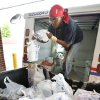 Letter carrier Sharice Yokley unloads a truck full of food collected along her route during the Letter Carriers\' Food Drive at the 301 W Britton Road Post Office in Oklahoma City, OK, Saturday, May 12, 2012, By Paul Hellstern, The Oklahoman