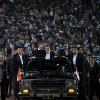 In this image released by the Egyptian Presidency taken on Saturday, Oct. 6, 2012, Egyptian President Mohammed Morsi, waves to the crowd gathered in a stadium upon his arrival for a speech on the 6th of October national holiday marking the 1973 war with Israel in Cairo, Egypt. Morsi boasts of his achievements in his first 100 days in office but sidesteps the key issues in the political transition to democratic rule. (AP Photo/Egyptian Presidency)