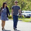 Photo - FILE- In this July 9, 2011 file photo, Mark Zuckerberg, president and CEO of Facebook, walks with Priscilla Chan during the 2011 Allen and Co. Sun Valley Conference, in Sun Valley, Idaho. Zuckerberg and his wife Chan were the most generous American philanthropists in 2013, with a donation of 18 million Facebook shares, valued at more than $970 million, given to a Silicon Valley nonprofit in December. (AP Photo/Julie Jacobson, File)