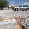 Heat has buckled the concrete roadway on North Lincoln near 38th Street in Oklahoma City, OK, Monday, July 18, 2011. By Paul Hellstern, The Oklahoman