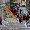 Rescue workers inspect a scene of a gas explosion downtown Prague, Czech Republic, Monday, April 29, 2013. A powerful explosion badly damaged an office building in the center of the Czech capital Monday, injuring up to 35 people. (AP Photo/Petr David Josek)