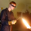 Edmond High School junior Sam Stokes adjusts the flame on an Oxy-acetylene torch at Edmond Schools Vocational-Agriculture complex in Edmond, Oklahoma March 10, 2009. Sam is deaf and uses a sign language interpreter in his class. BY STEVE GOOCH, THE OKLAHOMAN.