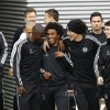 Photo - Chelsea's players Ramires, left, Willian, second left, David Luiz, second right, and Eden Hazard, right, arrive for a training session at Cobham in England Tuesday, April 29, 2014. Chelsea will play in a Champions League semifinal second leg soccer match against Atletico Madrid on Wednesday. (AP Photo/Kirsty Wigglesworth)