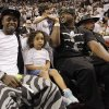 Lil Wayne, left, watches the first half at Game 3 of the NBA Finals basketball series between the Oklahoma City Thunder and the Miami Heat, Sunday, June 17, 2012, in Miami. (AP Photo/Lynne Sladky) ORG XMIT: NBA111