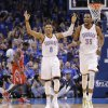 Oklahoma City's Russell Westbrook and Kevin Durant react Wednesday night after a 3-pointer by Kevin Martin during Game 2 in the first round of the NBA Playoffs between the Thunder and the Houston Rockets at Chesapeake Energy Arena in Oklahoma City. Photo by Chris Landsberger, The Oklahoman