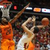 Photo - Iowa State's Georges Niang takes a shot as Oklahoma State's Michael Cobbins attempts to block during 1st half at Hilton Coliseum Wednesday, March 6, 2013, in Ames, Iowa. Photo by Nirmalendu Majumdar/Ames Tribune