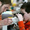 Nathan Fite, a member of the University of Oklahoma (OU) Botanical Society, helps 7-year-old Luke Scheffe, of Norman, with a microscope during Science in Action at the Sam Noble Oklahoma Museum of Natural History on Sunday, Feb. 15, 2009. By John Clanton, The Oklahoman