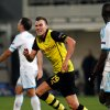 Photo - Dortmund's Kevin Grosskreutz, celebrates his side's 2nd goal during the Group F Champions League soccer match between Olympique Marseille and Borussia Dortmund at the Velodrome stadium in Marseille, Southern France, Wednesday, Dec. 11, 2013. (AP Photo/Claude Paris)