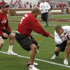 D.J. Wolfe tries to avoid Brian Bosworth (left) and Maylon Wesley during the OU Legends flag football game for the University of Oklahoma (OU) Sooners at Gaylord Family/Oklahoma Memorial Stadium on Saturday, April 17, 2010, in Norman, Okla. Photo by Steve Sisney, The Oklahoman