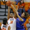 Kansas\' Monica Engelman (13) tries to pass the ball around Oklahoma State\'s Kendra Suttles (31) and Brittney Martin (22) during a women\'s college basketball game between Oklahoma State University (OSU) and Kansas at Gallagher-Iba Arena in Stillwater, Okla., Tuesday, Jan. 8, 2013. Oklahoma State won 76-59. Photo by Bryan Terry, The Oklahoman