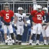 Photo - Penn State fullback Dominic Salomone (34) stands between quarterbacks Tyler Ferguson (5) and Steven Bench (12) on the sideline during the first half of their spring NCAA college football game on Saturday, April 20, 2013, in State College, Pa. (AP Photo/Keith Srakocic)